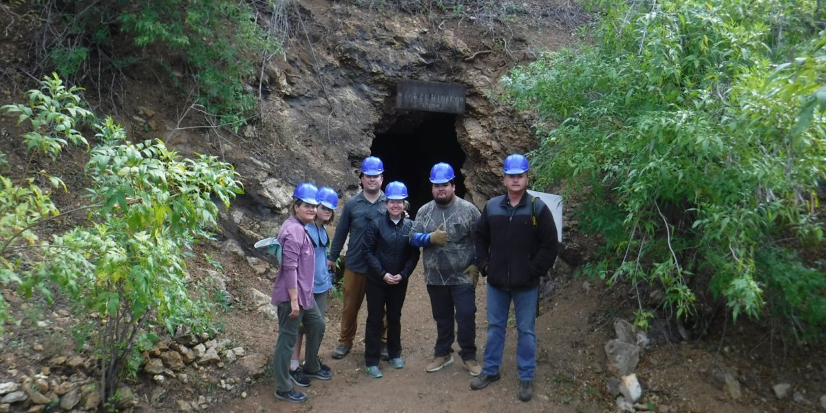 A small group explores the old mining town of El Triunfo