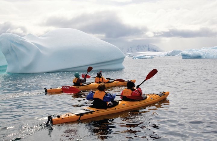 sea kayakers in antarctica