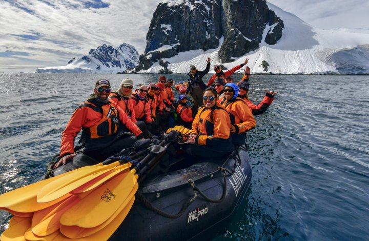 zodiac of sea kayakers in Antarctica