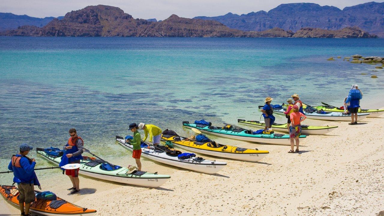 sea kayaks on beach in loreto marine park