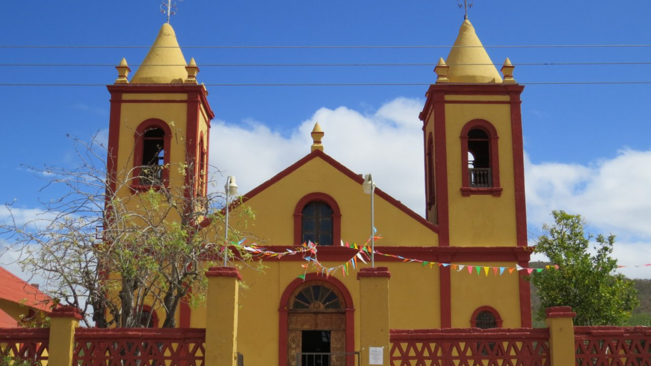 red and yellow church in historic baja town