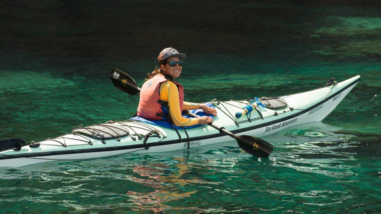woman in sea kayak, baja