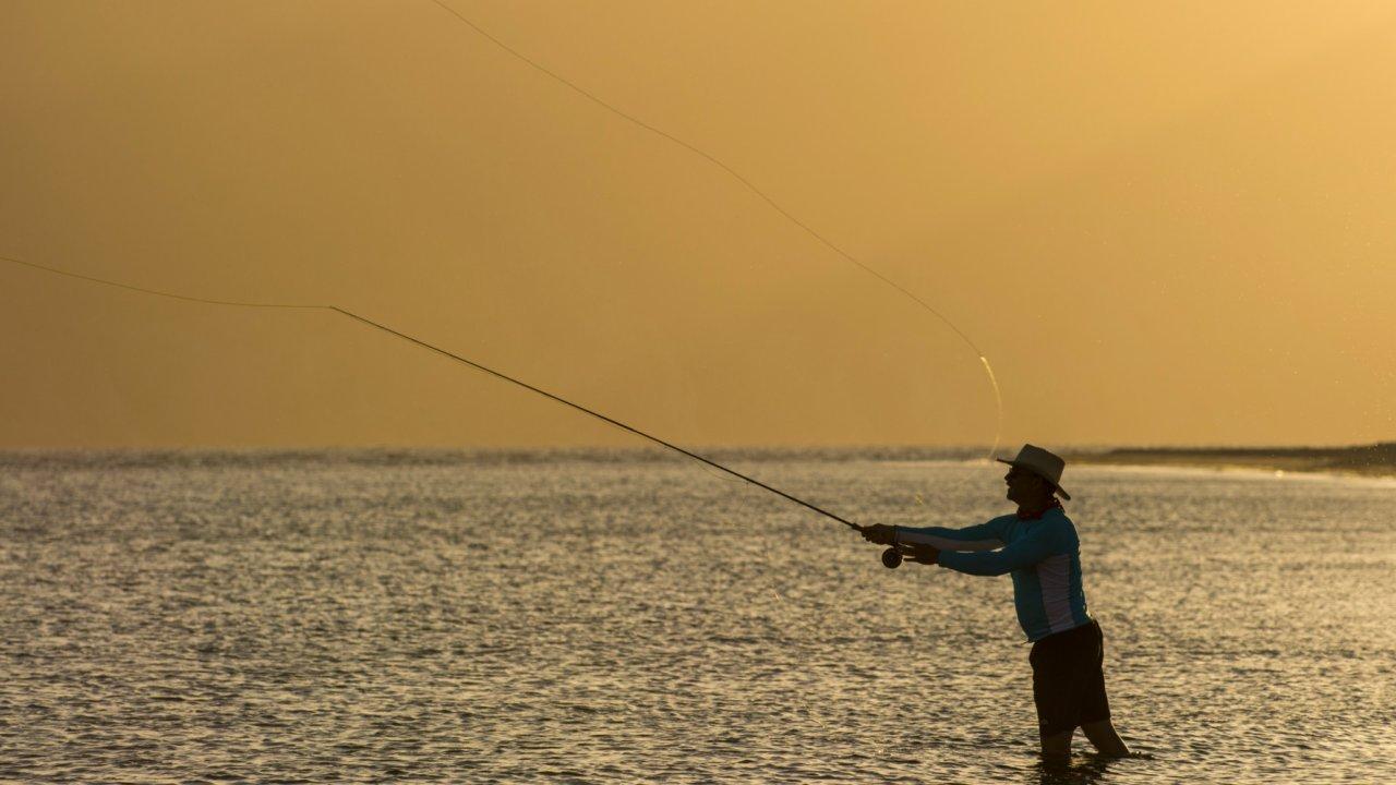 man fly fishing in baja