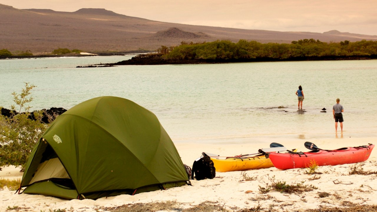 tent and sea kayaks galapagos islands