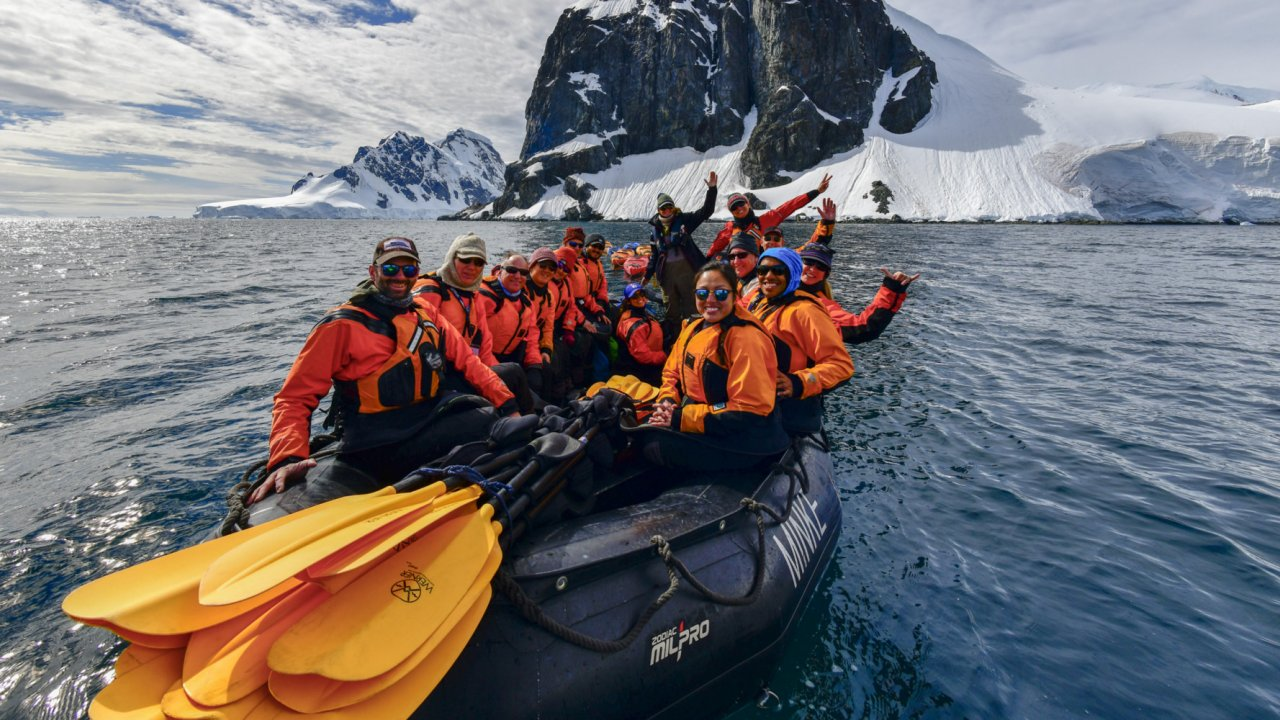 zodiac with paddlers in the Antarctic