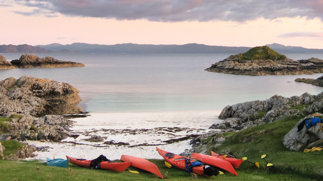 sea kayaks on beach in Scotland