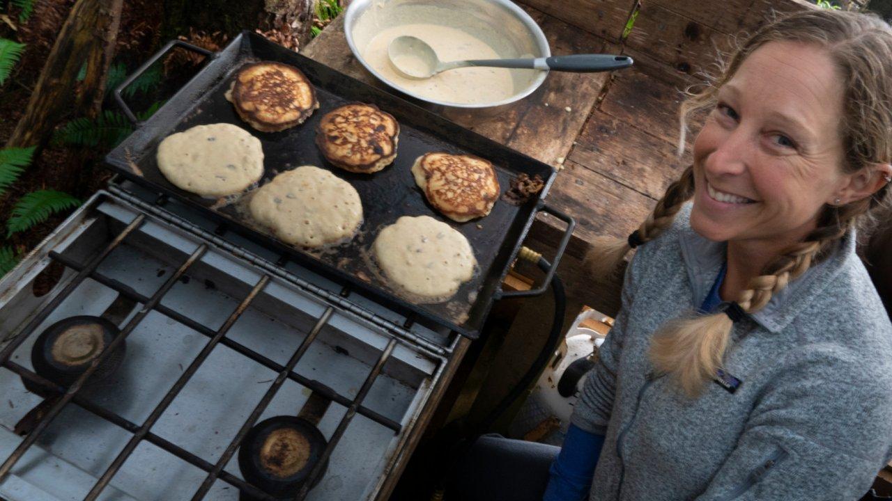 sea kayak guide cooking pancakes