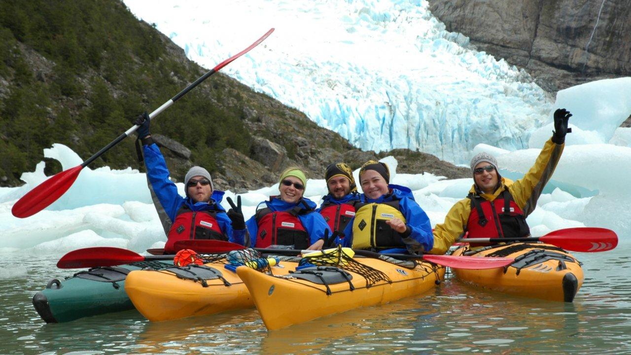 people in sea kayaks in patagonia