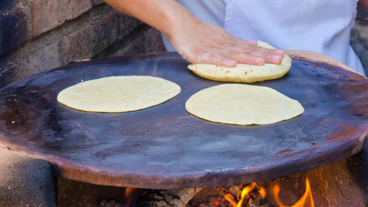 woman making authentic mexican tortillas