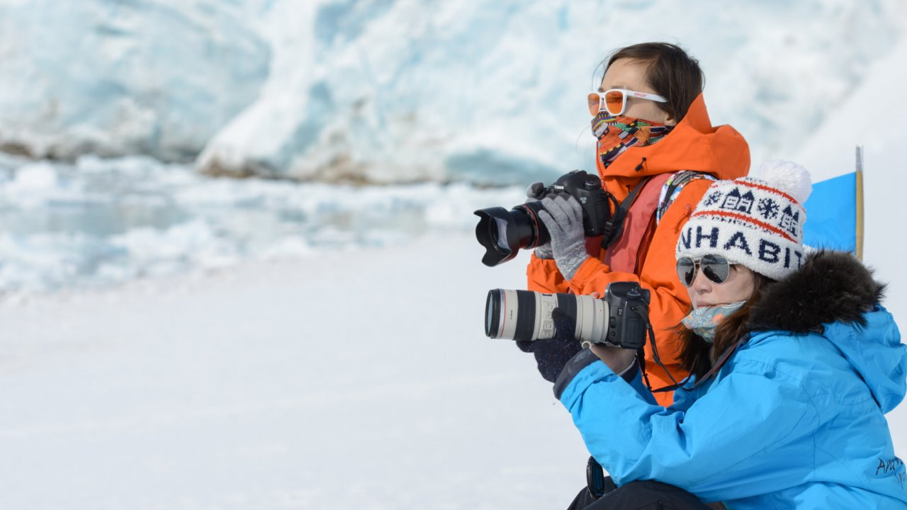 people with cameras in antarctica