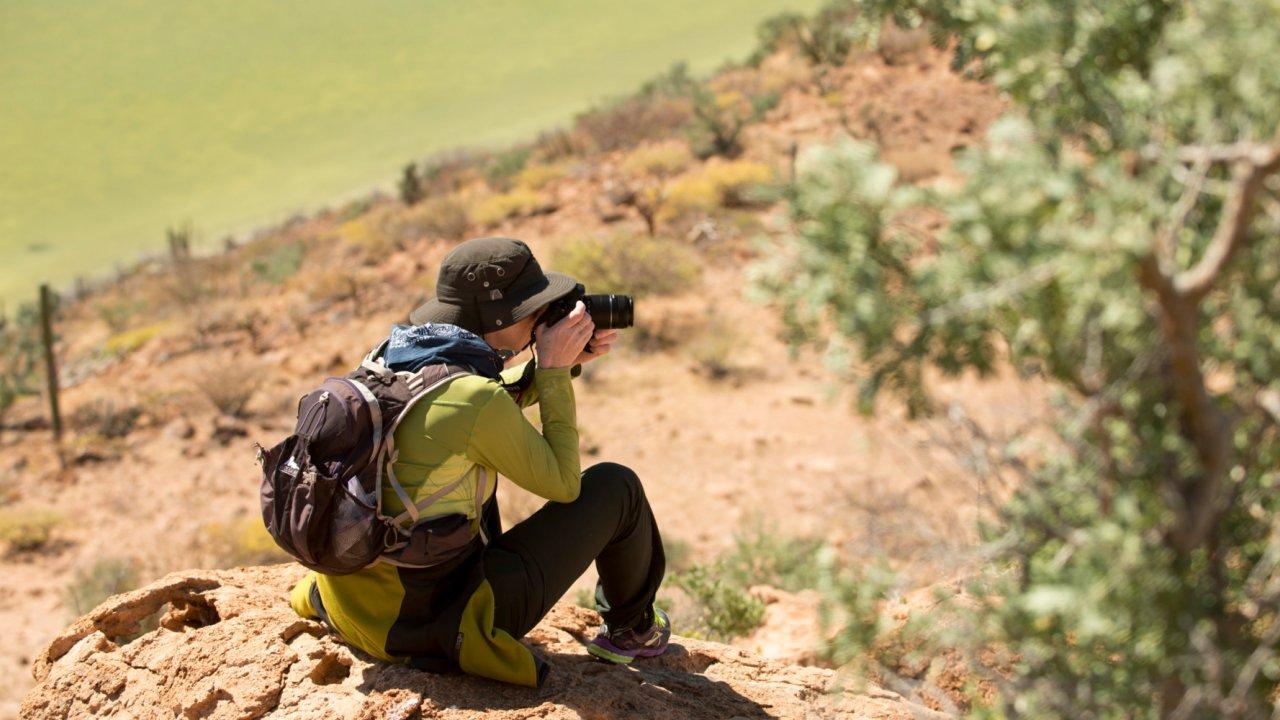 woman taking photograph in baja