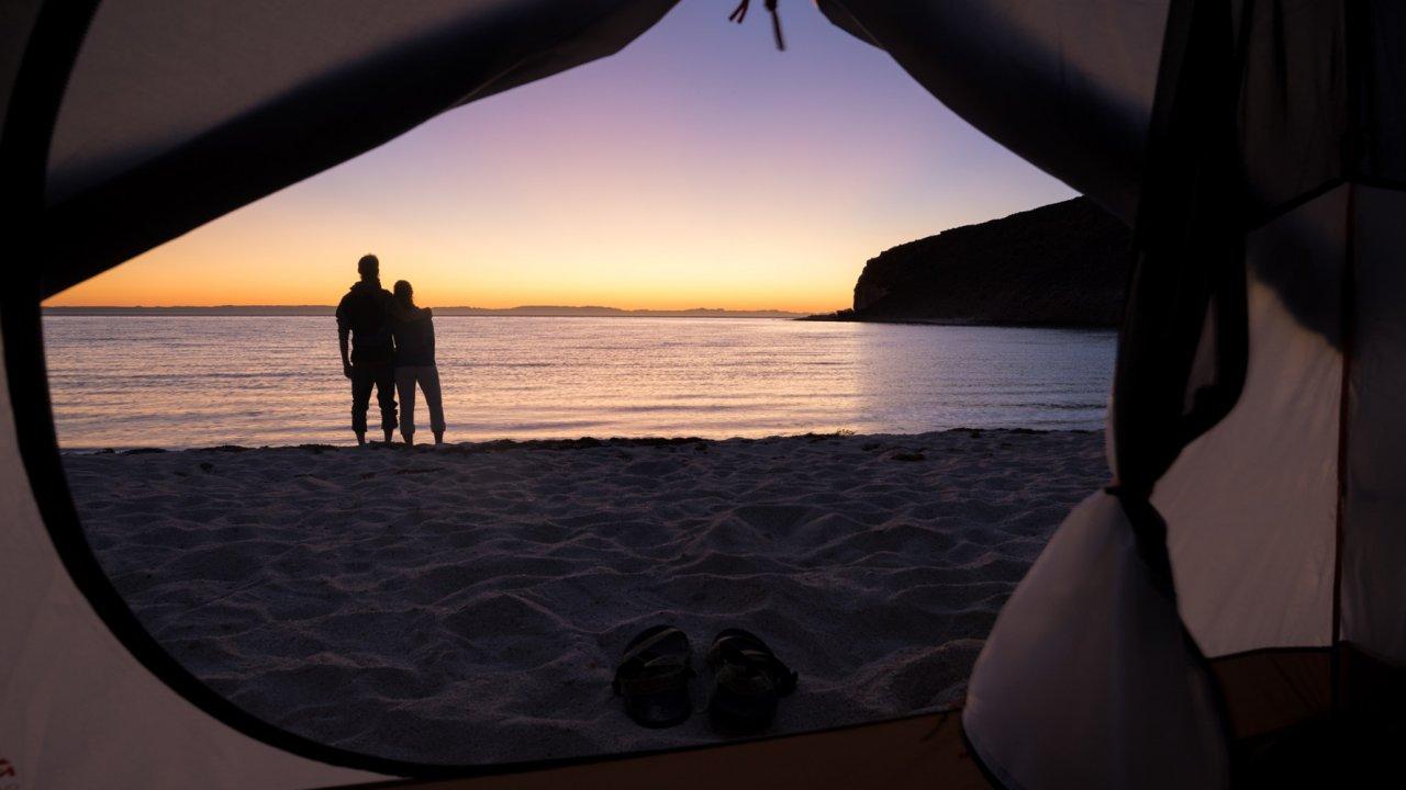 tent on baja beach at sunset