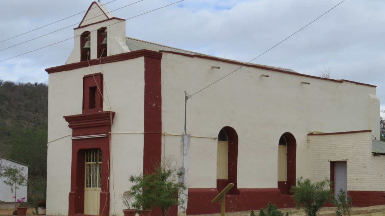 white and red historic church in baja
