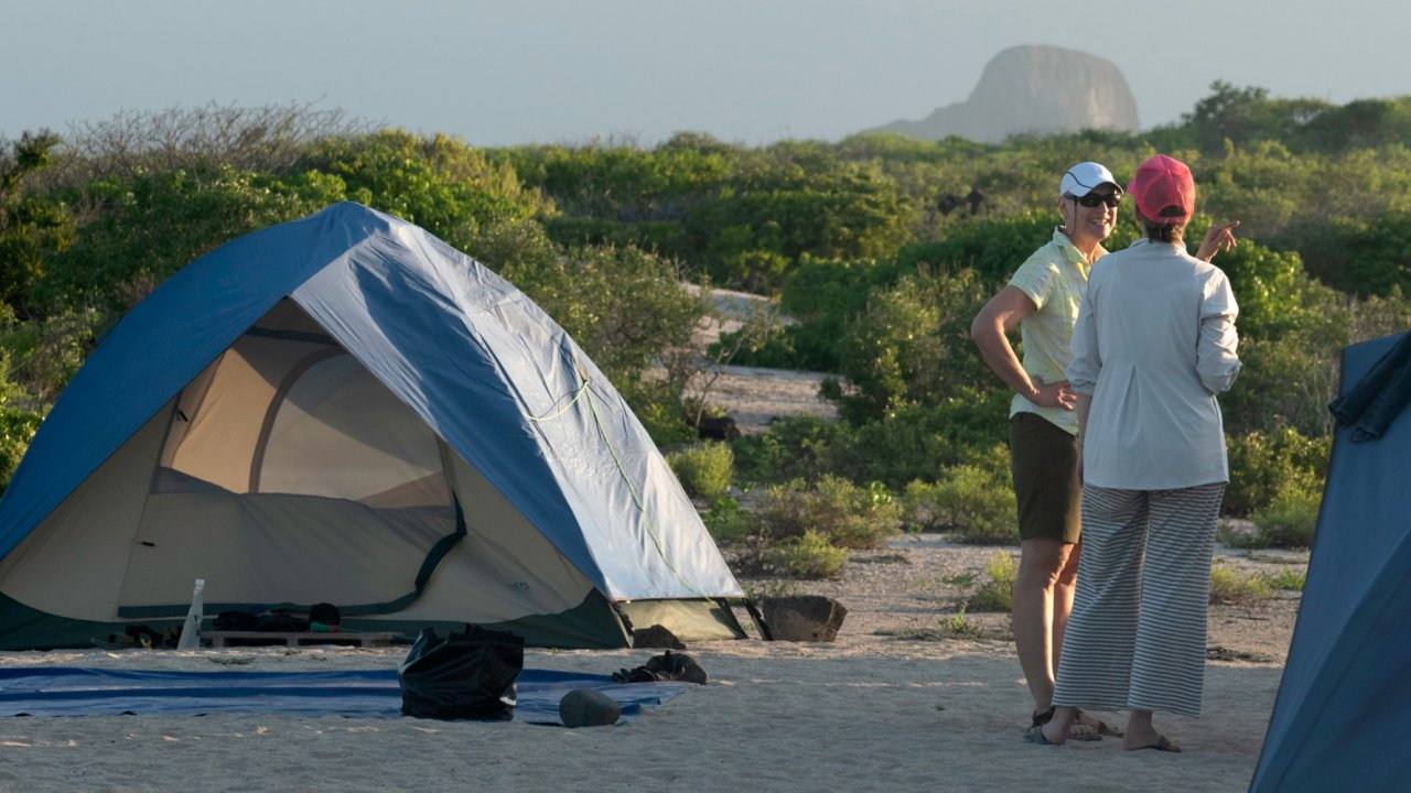 lady and tent in the galapagos