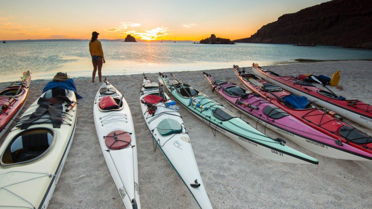 sea kayaks on beach in baja
