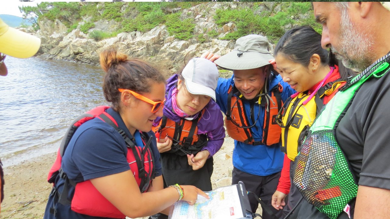 people looking at map on a kayak tour