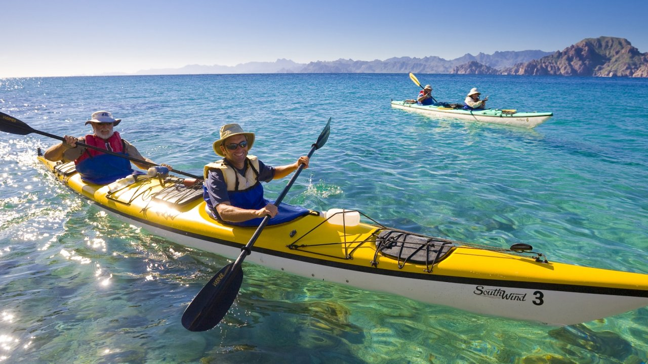 two men in a sea kayak