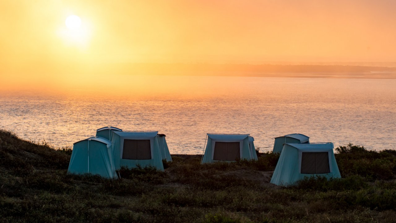 tents on beach in sunset