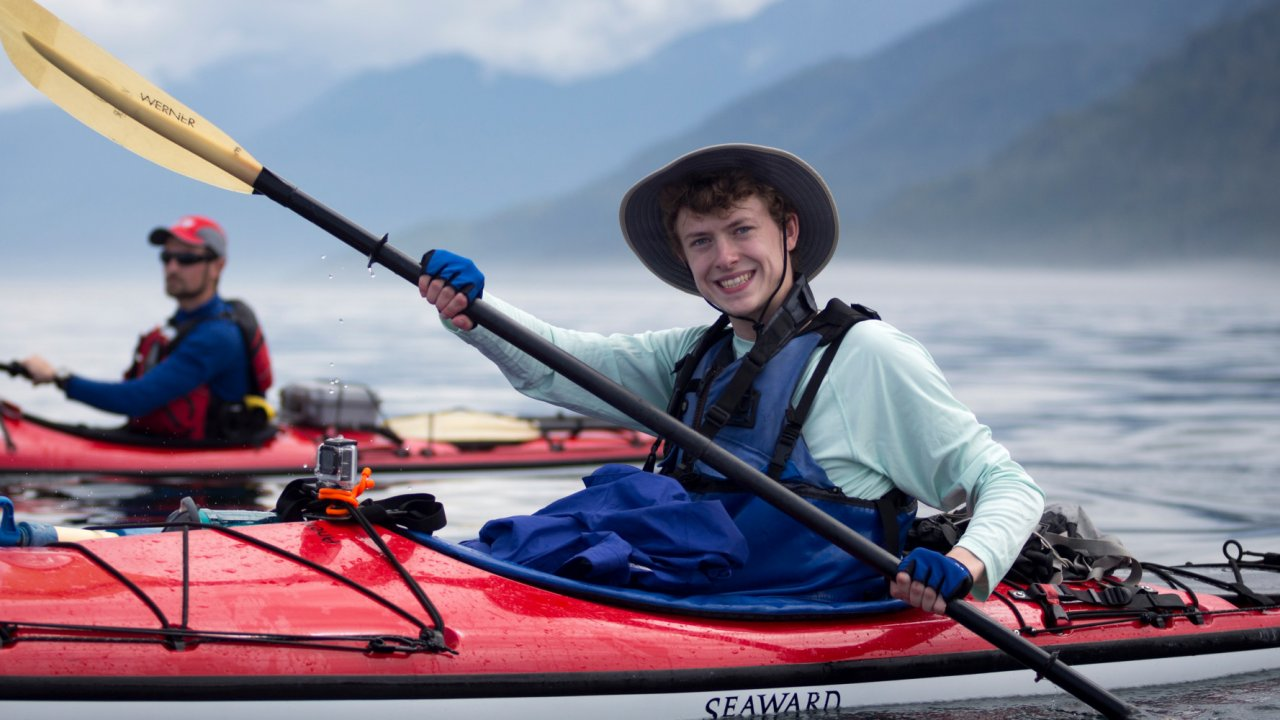 young man in a sea kayak