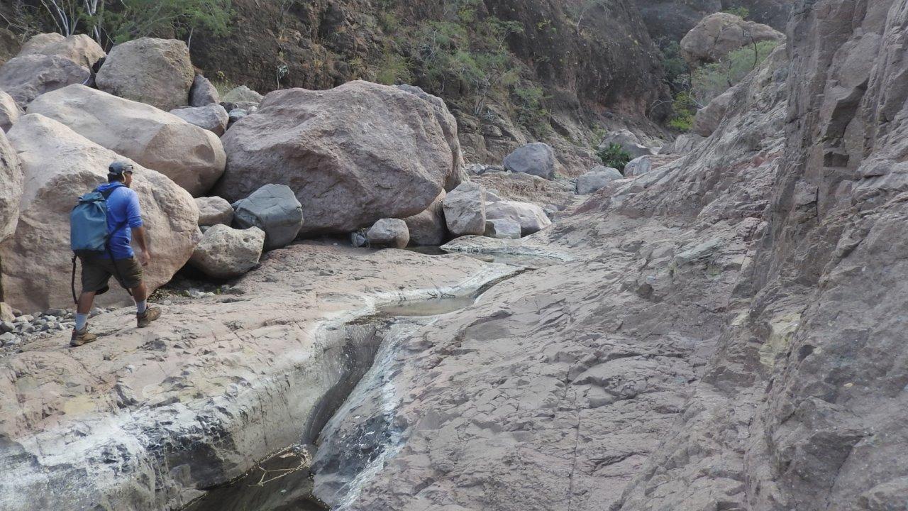 hiker in tabor canyon baja
