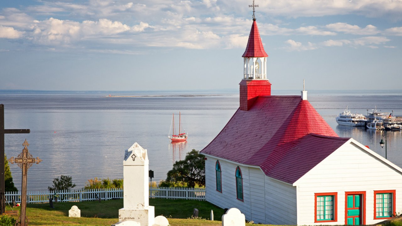 white and red church in tadoussac
