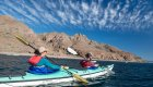 woman paddling sea kayak in Baja