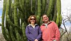 couple in front of large cactus in Baja